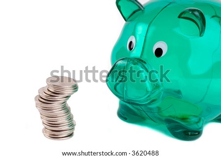 Green Plastic Piggy Bank With A Pile Of Coins, Isolated Over White - stock photo