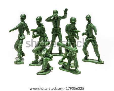 Green plastic soldiers on white background in formation - stock photo
