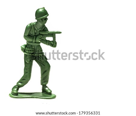 Green plastic soldiers on white background with gun - stock photo