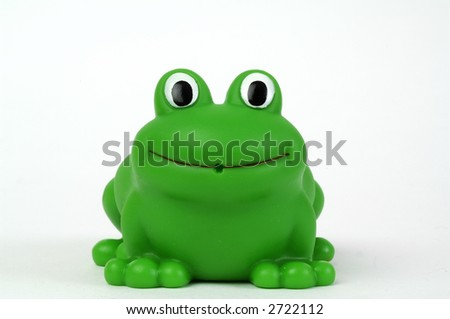 Green plastic toy frog on white background