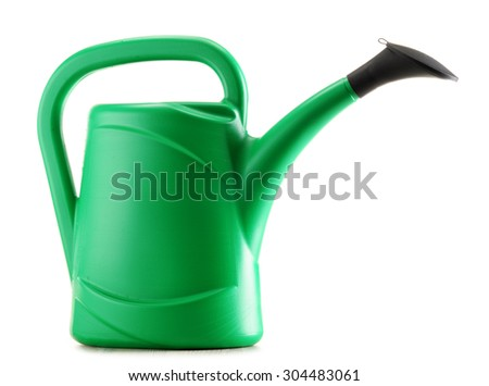 Green plastic watering can isolated on white background - stock photo