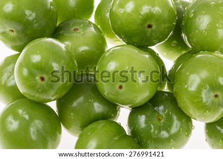 green plums as a background - stock photo