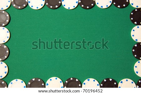 Green poker background with gambling chips all around - stock photo