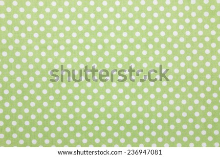 green polka dot fabric - stock photo