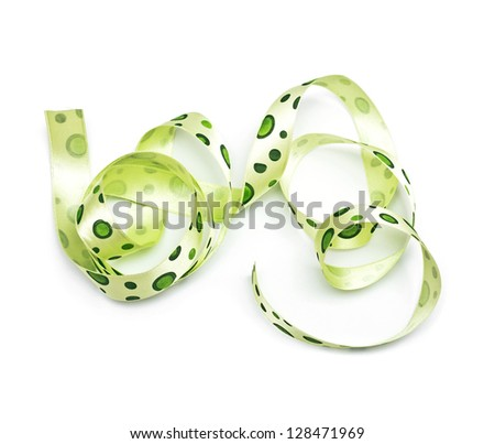 Green polka dot fabric ribbon on the white - stock photo
