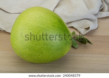 Green Pomelo - on the wooden background - stock photo