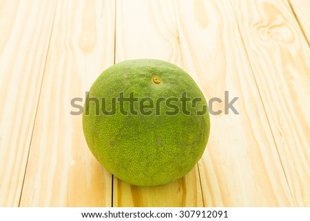 Green Pomelo - on the wooden background