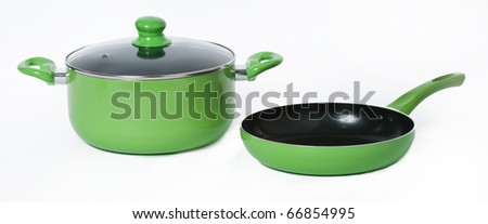Green pot an frying pan on a seamless white background - stock photo