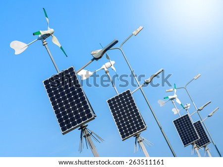 Green power, solar and wind energy infrastructure. - stock photo