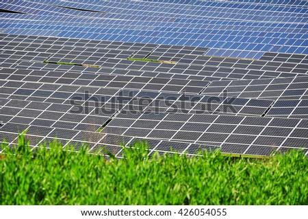 Green power solar energy plant - stock photo