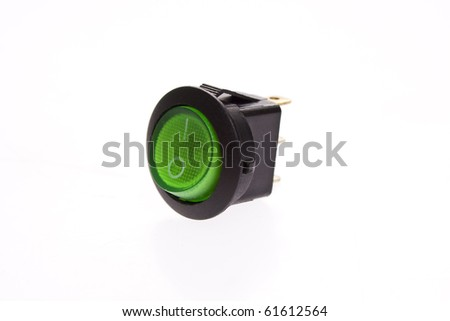 Green power switch in on position - stock photo