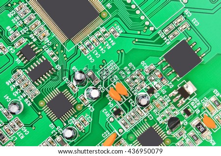 Green printed computer motherboard with microcircuit, close-up - stock photo