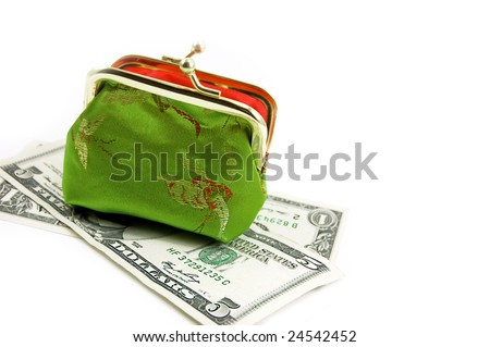 Green purse over dollar banknotes on white
