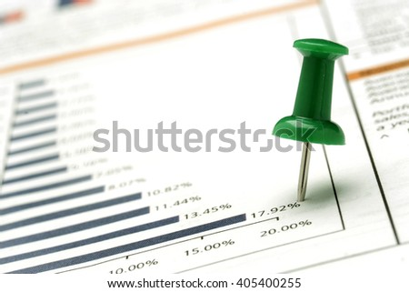 Green push pin on a pie chart - stock photo