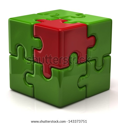 Green puzzle cube with one red piece - stock photo