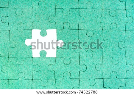 Green puzzle with missing piece