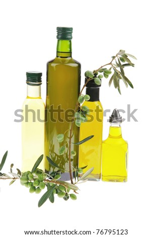 green raw olives on a branch with oil
