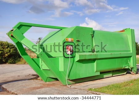green recycle skip waste with electric compressor - stock photo
