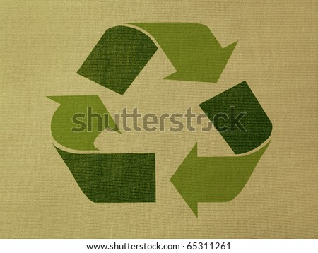 Green recycling symbol over a tissue background - stock photo
