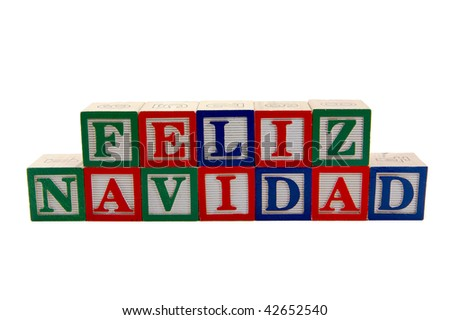 Green, Red, and blue wood Toy alphabet blocks spelling Feliz Navidad or Merry Christmas in Spanish