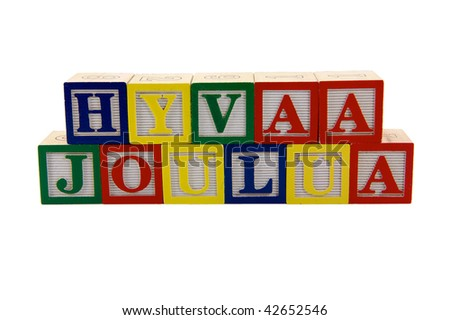 Green, Red, and blue wood Toy alphabet blocks spelling Hyvaa joulua or Merry Christmas in Finnish