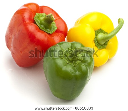 green, red and yellow pepper on white background