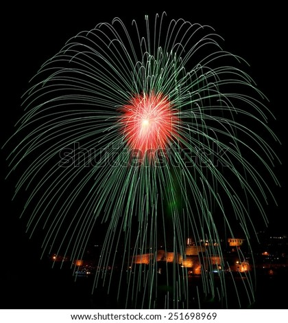 Green red fireworks isolated in dark background with the place for text and Valletta city on the bottom, Malta fireworks festival, 4 of July, Independence day, New Year, explode, fireworks festival - stock photo