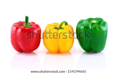 Green, red, yellow pepper is isolated on a white background  - stock photo