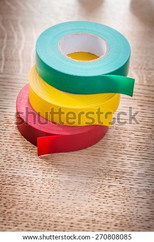 green red yellow rolls of insulating tape construction concept  - stock photo
