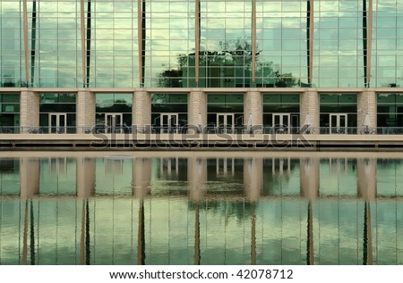 Green Reflections off the Illinois Department of Natural Resources Building - stock photo