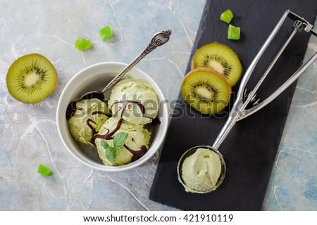Green refreshing pistachio ice cream in white bowl - stock photo