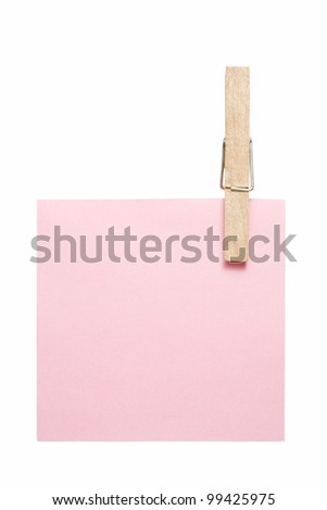 green reminder note with clothes pins isolated on white