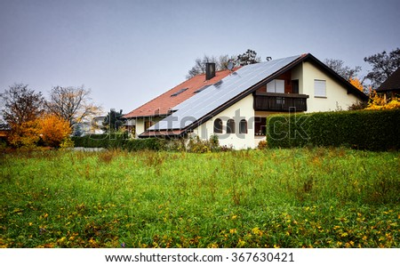 Green Renewable Energy. Photovoltaic Panels on the Roof. A completely solar energy powered house. - stock photo