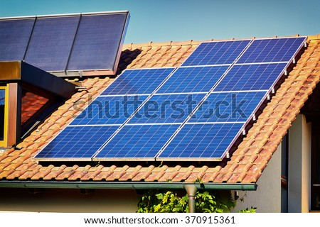 Green Renewable Energy. Photovoltaic Panels on the Roof. A completely solar energy powered house.
