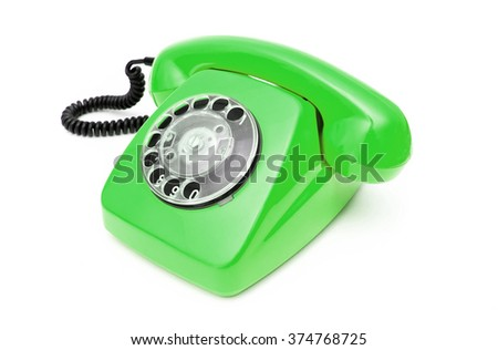 Green retro telephone isolated on white background.