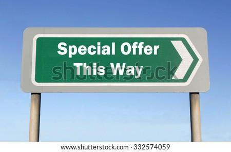 Green road sign with the message of a Special Offer This Way concept against a blue sky background