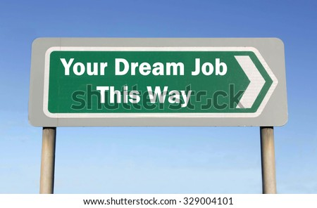 Green road sign with the message of a Your Dream Job This Way concept against a blue sky background - stock photo