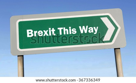 Green road sign with the message of an EU Crisis regarding a UK Brexit This Way concept against a blue sky background  - stock photo