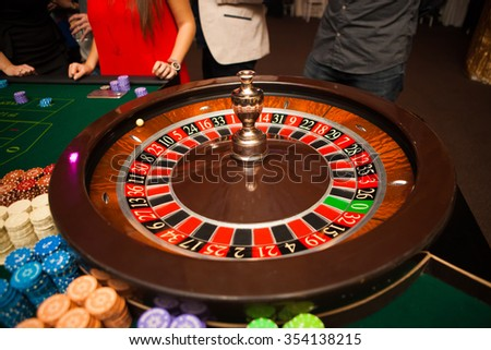 green roulette table with colored chips ready to play