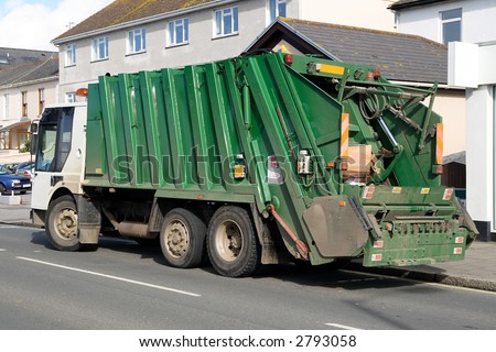 Green rubbish truck with boxes in the back. - stock photo
