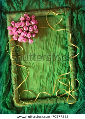 Green rumpled textile frame with yellow ribbon and rose heart - stock photo