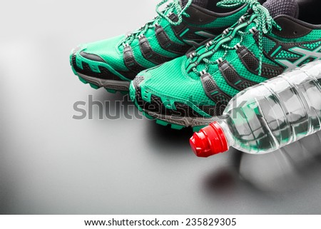 Green runners and a bottle - stock photo