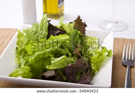 Green salad close up with green and red lettuce and spinach. - stock photo