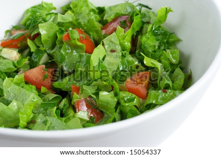 green salad in a bowl, shallow DOF - stock photo