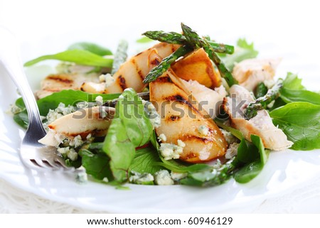 Green salad mix with pears and grilled asparagus - stock photo