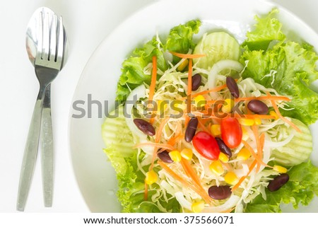 green salad plate fresh vegetable border on white background