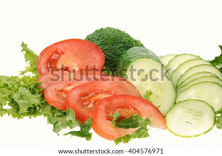 green salad, sliced tomato and cucumber isolated on the white background