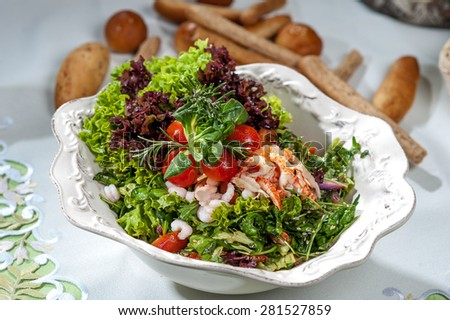 green salad with crayfish tails and prawns - stock photo
