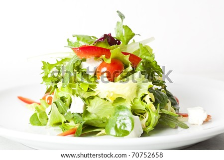 green salad with feta cheese, tomatoes and peppers - stock photo