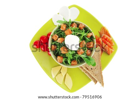 green salad with salmon and tomatoes on plate - stock photo